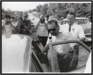 James Aubrey Norvell being arrested after shooting Meredith three times with a shotgun.